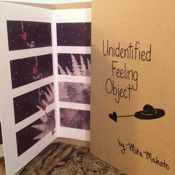 """Unidentified Feeling Object"" collaged newsprint (digital print; accordion-style book) 6 pp. 2012 BUY"